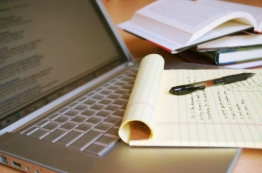 laptop-with-pen-and-books